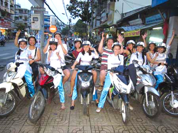 Motorbikes offer new spin on City tours - Halong Sapa packages
